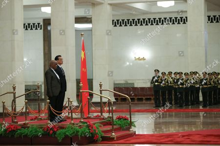 Stock Picture of Chinese Premier Li Keqiang (R) and Prime Minister of Lesotho, Thomas Motsoahae Thabane (L) listen to their national anthems during a welcoming ceremony inside the Great Hall of the People in Beijing, China, 06 September 2018.