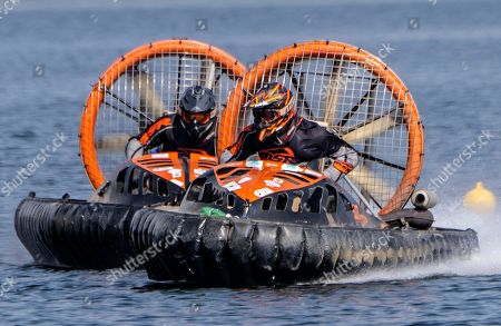 Stock Image of Lucas Hall of Sweden, left, and Tony Oesterman of Sweden, right, speed up during the F2 race training session at the Hovercraft World Championship on the accumulation lake 'Bleiloch' near Saalburg in Saalburg, Germany, . The World Championship will take place from 6th to 9th Sept. 2018