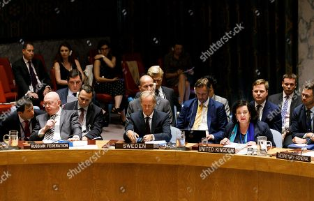 Karen Pierce (4-R), the United Kingdom's Ambassador to the United Nations, speaks as Vassily Nebenzia (2-L), Russian Ambassador to the United Nations, talks with his staff and Olof Skoog, Sweden's Ambassador to the United Nations, (7-L) listens during an emergency United Nations Security Council meeting called by the United Kingdom to discuss developments in the Salisbury nerve agent attack, which occurred in March, at United Nations headquarters in New York, New York, USA, 06 September 2018. The United Kingdom has named two Russian suspects in the nerve agent attack.