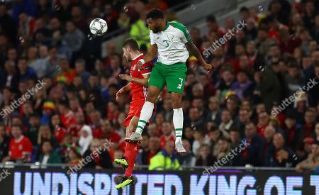 Cyrus Christie of Republic of Ireland outjumps Ben Davies of Wales