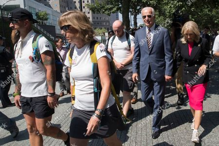 Joe Biden, Jill Biden. Former Vice President Joe Biden, second from right, and his wife Dr. Jill Biden, walk with members of Walking With The Wounded as they complete the 1,000-mile Walk of America, in New York