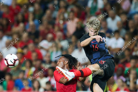 Portugal's Gelson Martins (L) vies for the ball with Croatia's Filip Bradaric  during the international friendly soccer match between Portugal and Croatia at Algarve Stadium, Faro, Portugal, 06 September 2018.