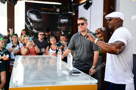 Stock Photo of Brian Dawkins, right, kicks off the search for the Courtyard NFL Global Correspondent while speaking with fans at the 2018 NFL Kickoff Experience on at Penn's Landing in Philadelphia