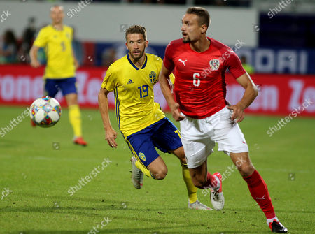 Sweden's Marcus Rohden and Austria's Stefan Ilsanker, from left, challenge for the ball during a friendly soccer match between Austria and Sweden in Vienna, Austria
