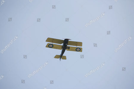 SE5A fighter plane from WW1 flypast over the church