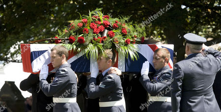 The coffin containing the body of Henry Allingham is carried out of the church by a joint Royal Navy and Royal Air Force bearer party