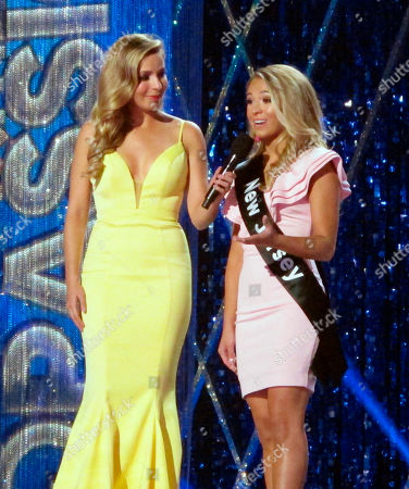 Stock Image of Miss America 2015 Kira Kazantsev, left, conducts an onstage interview with Miss New Jersey Jaime Gialloreto during the second night of preliminary competition in the Miss America competition in Atlantic City N.J. on . The pageant has replaced swimsuit competition this year with an onstage interview
