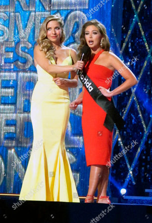 Miss America 2015 Kira Kazantsev, left, conducts an onstage interview with Miss Florida Taylor Tyson during the second night of preliminary competition in the Miss America competition in Atlantic City N.J. on . The pageant has replaced swimsuit competition this year with an onstage interview
