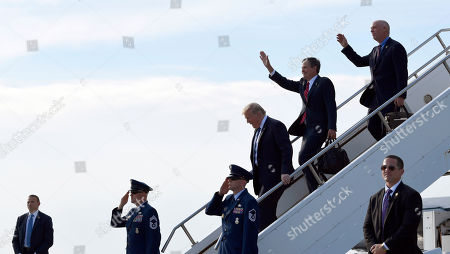 Donald Trump, Greg Gianforte, Steve Daines. President Donald Trump, third from right, walks off of Air Force One at Billings Logan International Airport in Billings, Mont., with Sen. Steve Daines, R-Mont., second from right, and Rep Greg Gianforte, R-Mont. Trump is in Montana for a rally