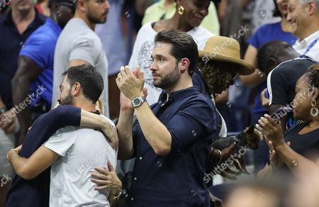 Alexis Ohanian, husband of Serena Williams, celebrates her semi-final victory as her mother Oracene Price holds Serena Williams's dog Chip in the Player's Box