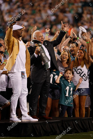 Philadelphia Eagles owner Jeffery Lurie celebrates with the Lombardi Trophy with NFL Hall of Famer Brian Dawkins and fans prior to the NFL game between the Atlanta Falcons and the Philadelphia Eagles at Lincoln Financial Field in Philadelphia, Pennsylvania