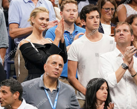 Karlie Kloss, Joshua Kushner. Karlie Kloss, top left, and Joshua Kushner attend the semifinals of the U.S. Open tennis tournament at the USTA Billie Jean King National Tennis Center, in New York