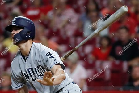 San Diego Padres' Wil Myers hits a double off Cincinnati Reds relief pitcher David Hernandez in the eighth inning of a baseball game, in Cincinnati