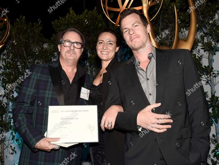 "John Papsidera, Lisa Joy, Jonathan Nolan. John Papsidera, Emmy nominee for outstanding casting for a drama series for ""Westworld,"" from left, Lisa Joy and Jonathan Nolan attend The Television Academy's Casting Directors Nominee Reception at Mr. C Beverly Hills, in Beverly Hills, Calif"