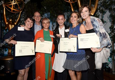 """Alissa Haight Carlton, Jen DeMartino, Sasha Alpert, Rebecca Snavely, Kentaro Kameyama, Jonathan Murray. Jonathan Murray, second from left, and Kentaro Kameyama, fourth from left, pose with Alissa Haight Carlton, from left, Jen DeMartino, Sasha Alpert and Rebecca Snavely, Emmy nominees for outstanding casting for a reality program for """"Project Runway,"""" at The Television Academy's Casting Directors Nominee Reception at Mr. C Beverly Hills, in Beverly Hills, Calif"""