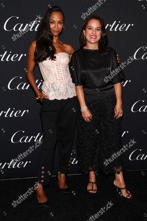 Stock Image of Zoe Saldana, Mercedes Abramo. Zoe Saldana, left, and Mercedes Abramo, right, attend the NYFW Spring/Summer 2019 Cartier Celebrates the Precious Garage Launch Event at the Cartier Fifth Avenue Mansion, in New York