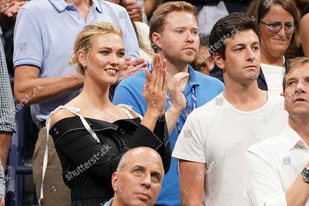 Stock Photo of Karlie Kloss, Joshua Kushner. Karlie Kloss, left, and Joshua Kushner attend the semifinals of the U.S. Open tennis tournament at the USTA Billie Jean King National Tennis Center, in New York