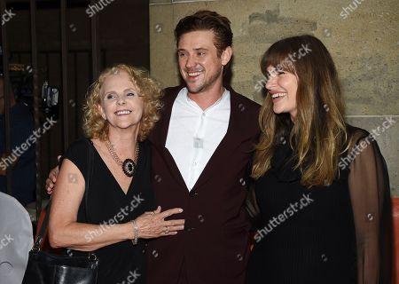 "Ellen Harris, Boyd Holbrook, Tatiana Pajkovic. Actor Boyd Holbrook, poses with his mother Ellen harris, left, and girlfriend Tatiana Pajkovic at the premiere for ""The Predator"" on day 1 of the Toronto International Film Festival, at the Ryerson Theatre, in Toronto"