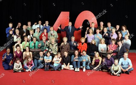 'Coronation Street'  TV - 2000 -  40th Anniversary  Cast :Left to right: Back row: Stephen Beckett (Dr Matt Ramsden); Chris Gascoyne (Peter Barlow); Richard Standing (Danny Hargreaves); Jimmi Harkishan (Dev Alahan); Simon Gregson (Steve McDonald); Tony Warren (Creator); Kevin Kennedy (Curly Watts); John Quayle (Anthony Stephens); Bruce Jones (Les Battersby); Sean Wilson (Martin Platt); Joan Kempson (Edna Miller). Second row: Angela Lonsdale (Emma Taylor); Malcom Hebden (Norris Cole); John Bowe (Duggie Ferguson); Sally Whittaker (Sally Webster); Michael Le Vell (Kevin Webster); Julie Hesmondhalgh (Hayley Cropper); David Neilson (Roy Cropper); Tracy Shaw (Maxine Peacock); Steven Arnold (Ashley Peacock); John Savident (Fred Elliott); Sue Cleaver (Eileen Grimshaw); Jacqueline Pirie (Linda Baldwin); Vicky Entwistle (Janice Battersby). Seated: Maggie Jones (Blanche Hunt); Anne Kirkbride (Deirdre Rachid); Betty Driver (Betty Williams); William Tarmey (Jack Duckworth); Liz Dawn (Vera Duckworth); Eileen Derbyshire (Emily Bishop); William Roache (Ken Barlow); Barbara Knox (Rita Sullivan); Helen Worth (Gail Platt); Sue Nicholls (Audrey Roberts); Amanda Barrie (Alma Halliwell); Johnny Briggs (Mike Baldwin). Front row: Jacqueline Kington (Molly Hardcastle); Jennifer James (Geena Gregory); Claire McGlinn (Charlie Ramsden); Alan Halsall (Tyrone Dobbs); Samia Ghadie (Maria Sutherland); Tina OíBrien (Sarah Platt); Nikki Sanderson (Candice Stowe); Suranne Jones (Karen Phillips); Naomi Russell (Bobbi Lewis); Georgia Taylor (Toyah Battersby); Chris Bisson (Vikram Desai); Scott Wright (Sam Kingston). Children: Emma Woodward (Sophie Webster); Helen Flanagan (Rosie Webster); Amy/Emily Walton (twins play Bethany Platt). Jack P Shepherd (David Platt)