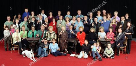 Stock Image of 'Coronation Street'  TV - 2000 -  40th Anniversary  Cast :Left to right: Back row:  Richard Standing (Danny Hargreaves); Jacqueline Kington (Molly Hardcastle); Stephen Beckett (Dr Matt Ramsden); Claire McGlinn (Charlie Ramsden); Jimmi Harkishan (Dev Alahan);Jennifer James (Geena Gregory); Chris Bisson (Vikram Desai);  Naomi Russell (Bobbi Lewis); Bruce Jones [Les Battersby]; Suranne Jones (Karen Phillips);  Scott Wright (Sam Kingston); Joan Kempson (Edna Miller); John Quayle (Anthony Stephens);  Sue Cleaver (Eileen Grimshaw); Chris Gascoyne (Peter Barlow). 2nd Row:  Emma Woodward (Sophie Webster); Helen Flanagan (Rosie Webster); Sally Whittaker (Sally Webster);  Michael Le Vell (Kevin Webster); Angela Lonsdale (Emma Taylor);  Kevin Kennedy (Curly Watts); Malcom Hebden (Norris Cole); Julie Hesmondhalgh (Hayley Cropper); David Neilson (Roy Cropper); Tracy Shaw (Maxine Peacock); Vicky Entwistle (Janice Battersby); Steven Arnold (Ashley Peacock); John Savident (Fred Elliott); Sean Wilson (Martin Platt); Simon Gregson (Steve McDonald);Georgia Taylor (Toyah Battersby);John Bowe (Duggie Ferguson);  Jacqueline Pirie (Linda Baldwin). Seated: Maggie Jones (Blanche Hunt); Anne Kirkbride (Deirdre Rachid); Betty Driver (Betty Williams); William Tarmey (Jack Duckworth); Liz Dawn (Vera Duckworth); Eileen Derbyshire (Emily Bishop); William Roache (Ken Barlow); Barbara Knox (Rita Sullivan); Helen Worth (Gail Platt); Sue Nicholls (Audrey Roberts); Amanda Barrie (Alma Halliwell); Johnny Briggs (Mike Baldwin). Front row: Monica the dog, Alan Halsall (Tyrone Dobbs); Samia Ghadie (Maria Sutherland); Nikki Sanderson (Candice Stowe); Tina OíBrien (Sarah Platt); Amy/Emily Walton (twins play Bethany Platt). Jack P Shepherd (David Platt) Copyright Granada Tv