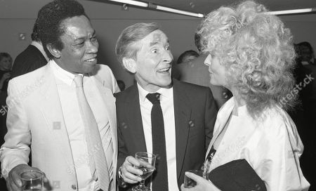 Kenneth Williams, Norman Beaton, with other guests at aftershow LWT party at South Bank studios.