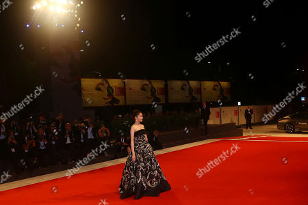 Guan Xiaotong poses for photographers at the premiere of the film 'Shadow' at the 75th edition of the Venice Film Festival in Venice, Italy
