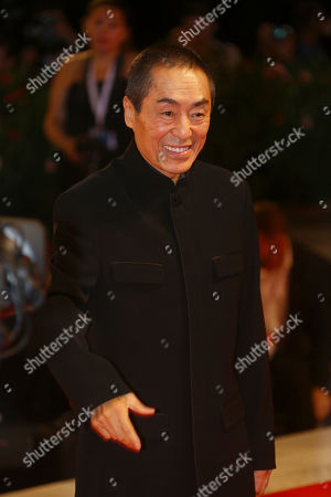 Zhang Yimou poses for photographers at the premiere of the film 'Shadow' at the 75th edition of the Venice Film Festival in Venice, Italy