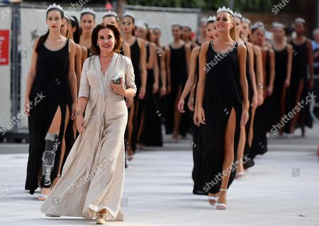 Organizer of the 'Miss Italy' beauty contest, Patrizia Mirigliani (C), with the 33 finalists of Miss Italy 2018 pageant arrive on the red carpet at the 75th annual Venice International Film Festival, in Venice, Italy, 07 September 2018. The festival runs from 29 August to 08 September.