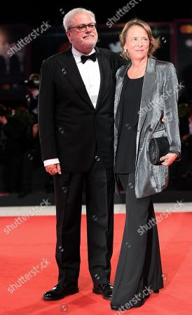 Italian filmmaker Roberto Ando (L) and guest arrive for the premiere of 'Una storia senza nome' during the 75th annual Venice International Film Festival, in Venice, Italy, 07 September 2018. The movie is presented out of competition at the festival running from 29 August to 08 September 2018.
