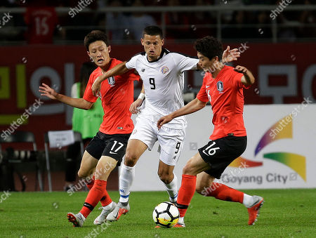 Stock Picture of Daniel Colindres, Ki Sung-yueng and Lee Jae-sung. Costa Rica's Daniel Colindres, center, fights for the ball against South Korea's Ki Sung-yueng and Lee Jae-sung, left, during their friendly soccer match in Goyang, South Korea