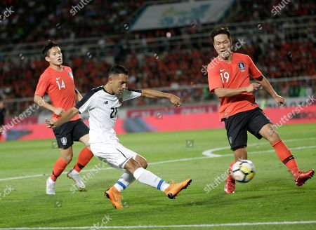 Jimmy Marin, Kim Young-gwon. Costa Rica's Jimmy Marin, center, kicks the ball as South Korea's Kim Young-gwon, right, tries to block during their friendly soccer match in Goyang, South Korea