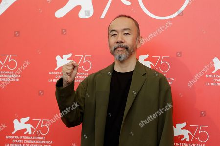 Director Shinya Tsukamoto poses for photographers at the photo call for the film 'Killing' at the 75th edition of the Venice Film Festival in Venice