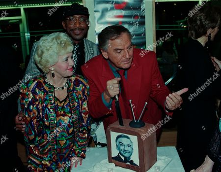 Bob Monkhouse, Lynne Perrie, Derrick Errol Evans aka Mr Motivator, with other guests at aftershow LWT party at South Bank studios.