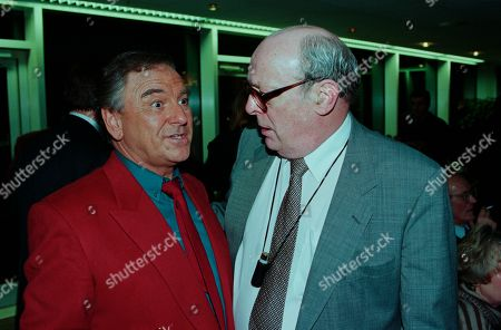 Stock Picture of Bob Monkhouse, John Junkin, with other guests at aftershow LWT party at South Bank studios.