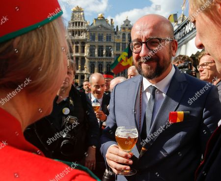 Belgian Prime Minister Charles Michel (C) holds a glass of beer as he along with other official guests attends the opening of the 20th edition of the Belgian Beer Weekend on Brussels' Grand Place in downtown Brussels, Belgium, 09 September  2018. The Belgium Prime Minister as well as the CEO of ICEO d'Anheuser-Busch InBev Carlos Brito were enthroned as 'Chevaliers' during a ceremony. More that 400 kinds of beers are presented during this events.