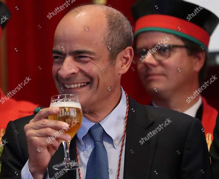 Brazilian Carlos Brito (L), CEO of the world's largest brewery company Anheuser-Busch InBev., smiles as he along with other official guests attends the opening of the 20th edition of the Belgian Beer Weekend in downtown Brussels, Belgium, 07 September 2018. Others are not identified. Brito and the Belgium Prime Minister Charles Michel (unseen) were both enthroned as 'Chevaliers' during a ceremony. More that 400 kinds of beers are presented during this events.