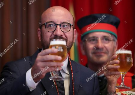 Belgian Prime Minister Charles Michel toasts with a glass of beer as he along with other official guests drinks from a glass of beer as he along with other official guests attends the opening of the 20th edition of the Belgian Beer Weekend in downtown Brussels, Belgium, 07 September 2018. Others are not identified. Michel and Brazilian Carlos Brito (unseen), CEO of the world's largest brewery company Anheuser-Busch InBev., were both enthroned as 'Chevaliers' during a ceremony. More that 400 kinds of beers are presented during this events.