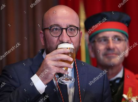 Belgian Prime Minister Charles Michel drinks from a glass of beer as he along with other official guests drinks from a glass of beer as he along with other official guests attends the opening of the 20th edition of the Belgian Beer Weekend in downtown Brussels, Belgium, 07 September 2018. Others are not identified. Michel and Brazilian Carlos Brito (unseen), CEO of the world's largest brewery company Anheuser-Busch InBev., were both enthroned as 'Chevaliers' during a ceremony. More that 400 kinds of beers are presented during this events.
