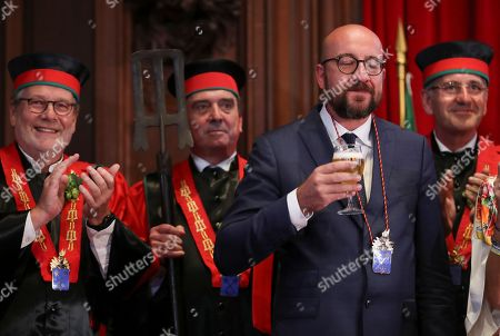 Belgian Prime Minister Charles Michel (2-R) seems to enjoy the taste of a glass of beer as he along with other official guests drinks from a glass of beer as he along with other official guests attends the opening of the 20th edition of the Belgian Beer Weekend in downtown Brussels, Belgium, 07 September 2018. Others are not identified. Michel and Brazilian Carlos Brito (unseen), CEO of the world's largest brewery company Anheuser-Busch InBev., were both enthroned as 'Chevaliers' during a ceremony. More that 400 kinds of beers are presented during this events.