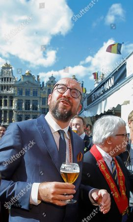 Belgian Prime Minister Charles Michel (R) holds a glass of beer as he along with other official guests attends the opening of the 20th edition of the Belgian Beer Weekend on Brussels' Grand Place in downtown Brussels, Belgium, 09 September  2018. The Belgium Prime Minister as well as the CEO of ICEO d'Anheuser-Busch InBev Carlos Brito were enthroned as 'Chevaliers' during a ceremony. More that 400 kinds of beers are presented during this events.
