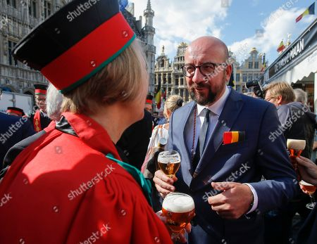 Belgian Prime Minister Charles Michel (R) speaks with an unidentified member of the Belgian Brewers' association (L) as he along with other official guests attends the opening of the 20th edition of the Belgian Beer Weekend on Brussels' Grand Place in downtown Brussels, Belgium, 09 September  2018. The Belgium Prime Minister as well as the CEO of ICEO d'Anheuser-Busch InBev Carlos Brito were enthroned as 'Chevaliers' during a ceremony. More that 400 kinds of beers are presented during this events.