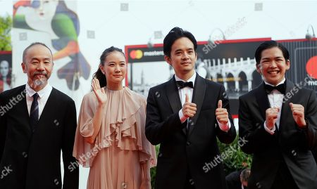 Director Shinya Tsukamoto, left, and actors Yu Aoi, second left, Sosuke Ikematsu, second right, and Ryusei Maeda, right, pose for photographers upon arrival at the premiere of the film 'Killing' at the 75th edition of the Venice Film Festival in Venice, Italy