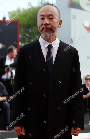 Director Shinya Tsukamoto poses for photographers upon arrival at the premiere of the film 'Killing' at the 75th edition of the Venice Film Festival in Venice, Italy