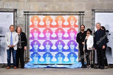 Megan Brennan, Bob Gruen, Yoko Ono and Sean Lennon unveil the stamp design