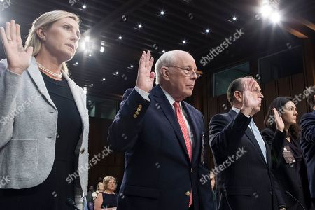Former counsel to US President Richard Nixon John Dean (C) is sworn-in to testify beside Washington DC real estate agent Monica Mastal (L) and others on a witness panel of the Senate Judiciary Committee's confirmation hearing on circuit judge Brett Kavanaugh's nomination to be an Associate Justice of the Supreme Court of the United States, on Capitol Hill in Washington, DC, USA, 07 September 2018. President Trump nominated Kavanaugh to fill the seat of retiring justice Anthony Kennedy. If confirmed, Kavanaugh would give conservatives a five-member majority in the high court.