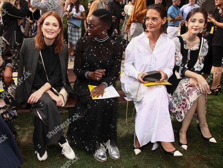 Julianne Moore, Danai Gurira, Katie Holmes, Guli Nazha. Julianne Moore, from left, Danai Gurira Katie Holmes and Guli Nazha attend the NYFW Spring/Summer 2019 Tory Burch fashion show at the Cooper Hewitt Smithsonian Design Museum, in New York