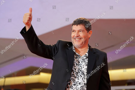 Director Pierre Schoeller poses for photographers upon arrival at the premiere of the film 'One Nation One King' at the 75th edition of the Venice Film Festival in Venice, Italy