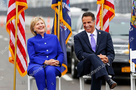 Former Secretary of State Hillary Clinton, left, sits with New York Gov. Andrew Cuomo for the officially opening of the Gov. Mario M. Cuomo Bridge, in Nyack, N.Y. The new bridge's first span opened last year, when the structure was named to honor Mario Cuomo, governor from 1983 to 1994, and Andrew Cuomo's father