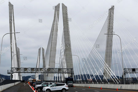 Stock Image of Cars are parked on the Gov. Mario M. Cuomo Bridge during its official opening, in Nyack, N.Y. The new bridge's first span opened last year, when the structure was named to honor Mario Cuomo, New York's governor from 1983 to 1994 and father of the state's current chief executive, Andrew Cuomo