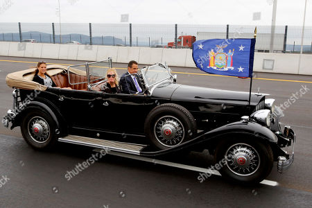New York Gov. Andrew Cuomo drives a 1932 Packard as his girlfriend, TV chef Sandra Lee, blows a kiss as they cross the Gov. Mario M. Cuomo Bridge, in Nyack, N.Y. Cuomo officially opened the second span of the new Hudson River Bridge that bears his father's name